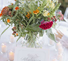 Colourful table centrepiece with flowers