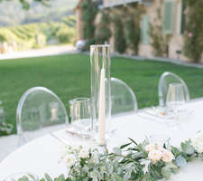 Wedding table decor details - tapers and green garland